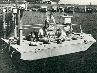 William Hakkarinen (standing) with the NOMAD buoy, Chesapeake Bay, c. 1956